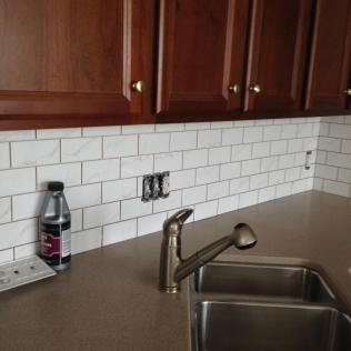Subway tiles by sink