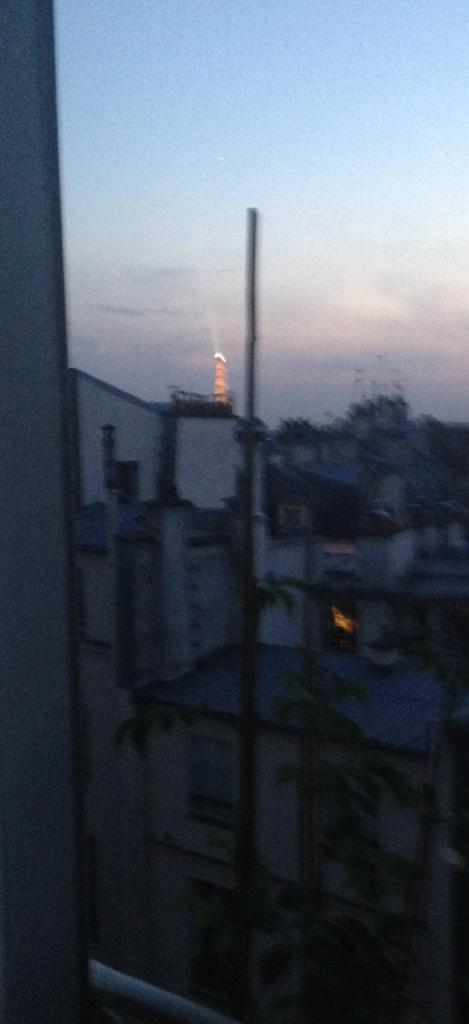 Paris.  Last Night.Daniele's Apt. View from her window. Eiffel Tower lights just coming on. Bidding us bye!