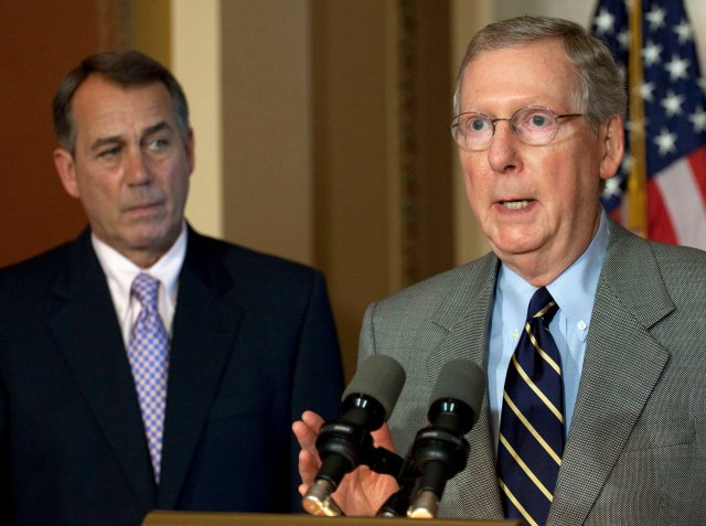 Senate Minority Leader Mitch McConnell, R-Ky., speaks at a news conference as House Speaker John Boehner of Ohio listens as the debt crisis goes unresolved on Capitol Hill in Washington, Saturday, July 30, 2011. (AP Photo/Harry Hamburg)