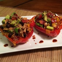 Roasted Red Peppers stuffed with shredded Chipotle Chicken, Quinoa, Black Beans, Cheddar Cheese, Tomato & Avocado!