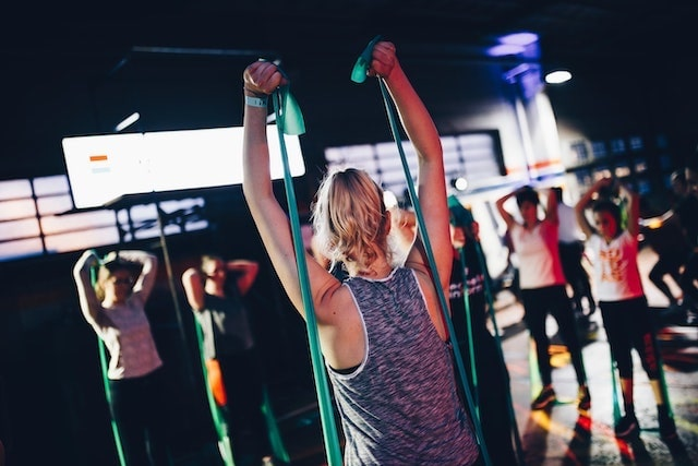 Female instructor leading fitness band class