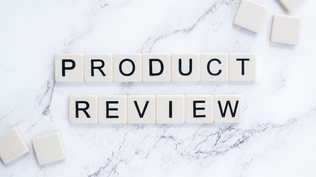"""Lettered tiles spelling """"product review"""" on marble surface"""
