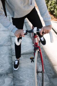 Person getting ready to ride a bike