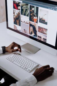 Person scrolling through stock photos on desktop computer