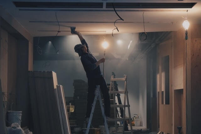 Person working inside a home under construction