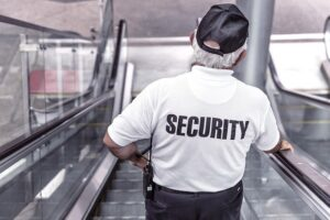 Security officer riding an escalator