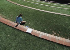 Student reads a book, while enjoying the weather at D. Douglas Barnard, Jr. Amphitheatre. (Photo: Jamie Sapp)