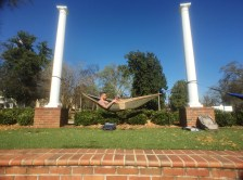 Junior marketing major Justin Rye reads a book, while enjoying the weather in a hammock. (Photo: Sarah Carter)