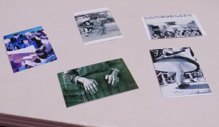 On the table shows various historic photos for the performing photos workshop. (Photo: Jamie Sapp)