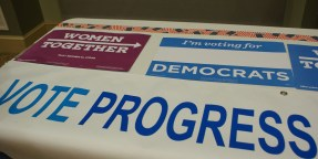 Here are some signs placed on a table from the Young Democrats of Augusta-Richmond County. (Photo: Kait Fruechting)