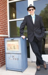 Senior art major Baillie Conway is using his design model for one of newsstand boxes at the JSAC. (Photo: Jamie Sapp)