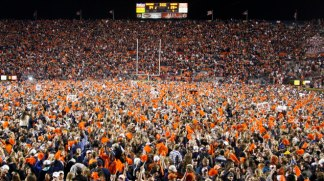 Auburn fans react at the end of a win over Alabama during the second half of an NCAA college football game in Auburn, Ala., Saturday, Nov. 30, 2013. Auburn beat Alabama 34-28. (AP Photo/Skip Martin)