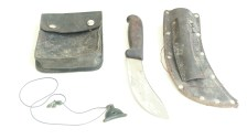 Film Still. Pig hunt tools, including dog whistle and knife