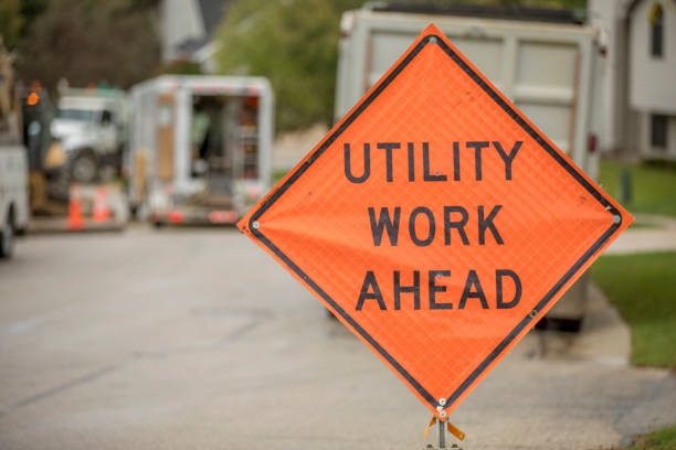 Road construction safety sign, Utility Work Ahead, while repairing a street. auburn, auburn way s