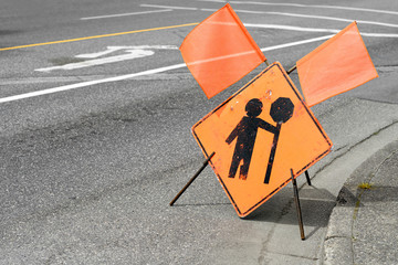flagger, road work ahead