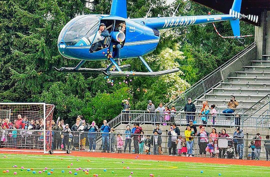 the hop, REVIVE Auburn, easter egg hunt, easter eggs from a helicopter, easter bunny, awesome inc, bounce house, community, community event, auburn memorial stadium,