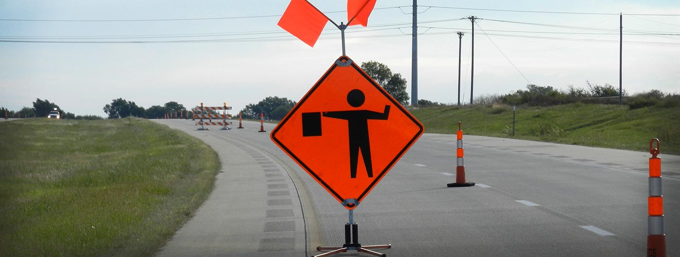 flagger, road work, construction, road work sign
