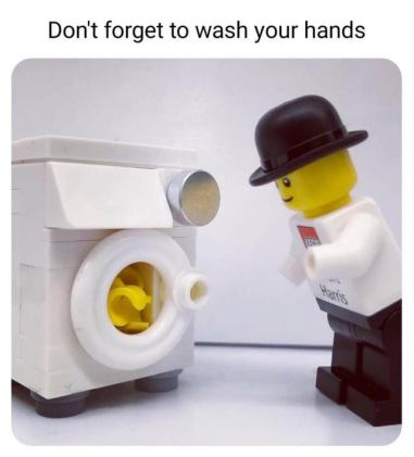A lego man stands in front of a lego washing machine looking at his hands inside a Leho washing machine. Above the photo says :Don't forget to wash your hands