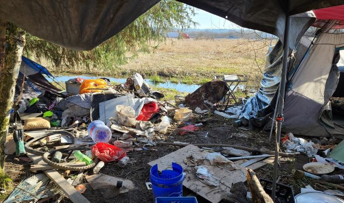 Looking outward toward SR-167 from inside a tent within a homeless encampment in the Auburn Environmental Park.