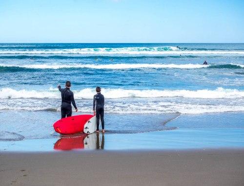 Piha Beach Surfer - West Auckland, New Zealand