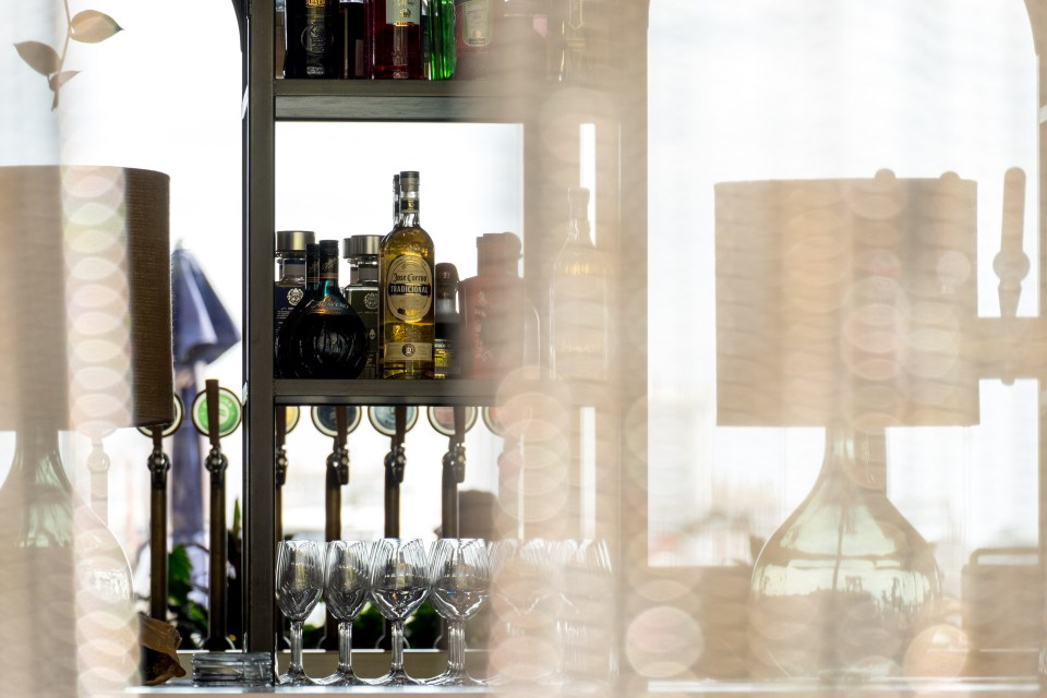 liquor bottles behind curtain in bar in Wynyard Quarter