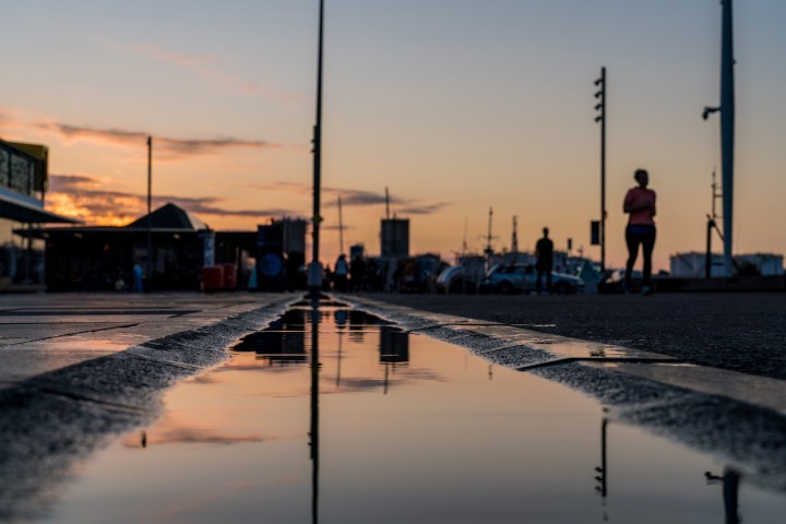 Wynyard Quarter Sunset Reflection in Water Puddle - Street Photography Auckland