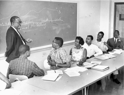 Dr. J.R. Coan teaches students in his classroom, circa 1963
