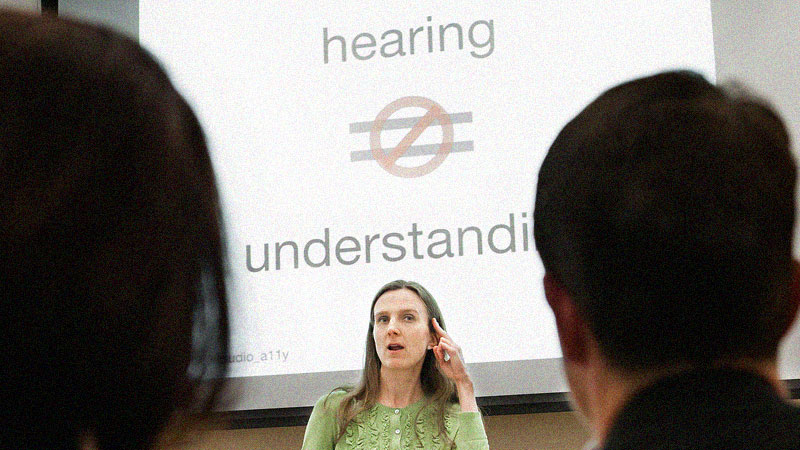 Svetlana in front of slide saying: hearing does not equal understanding