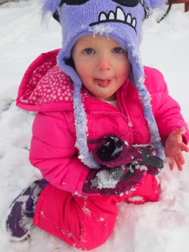 "Classic Ellen, gloveless in the snow. One day I spent a lot of time bundling her up and 10 seconds out the door her gloves were off. Exasperatedly I asked, ""Why did you take your gloves off?"" She replied, ""I have to get a booger out of my nose."""
