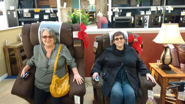 Glenna's sisters trying out chairs for her. The recliner they got her was actually one of the most useful things she had in her final months.