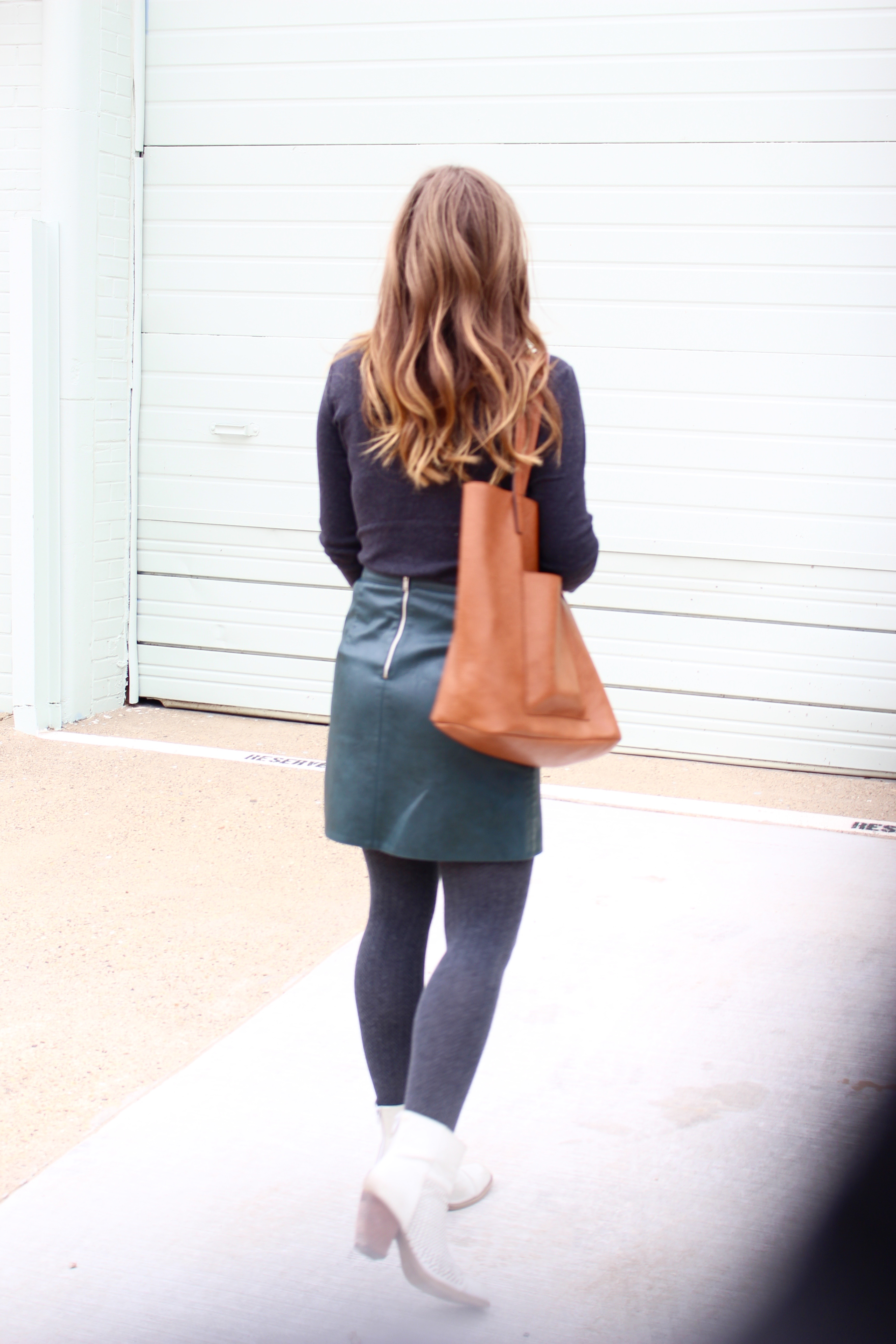 complete outfit of a leather skirt - Green Leather Skirt by popular Texas fashion blogger Audrey Madison Stowe