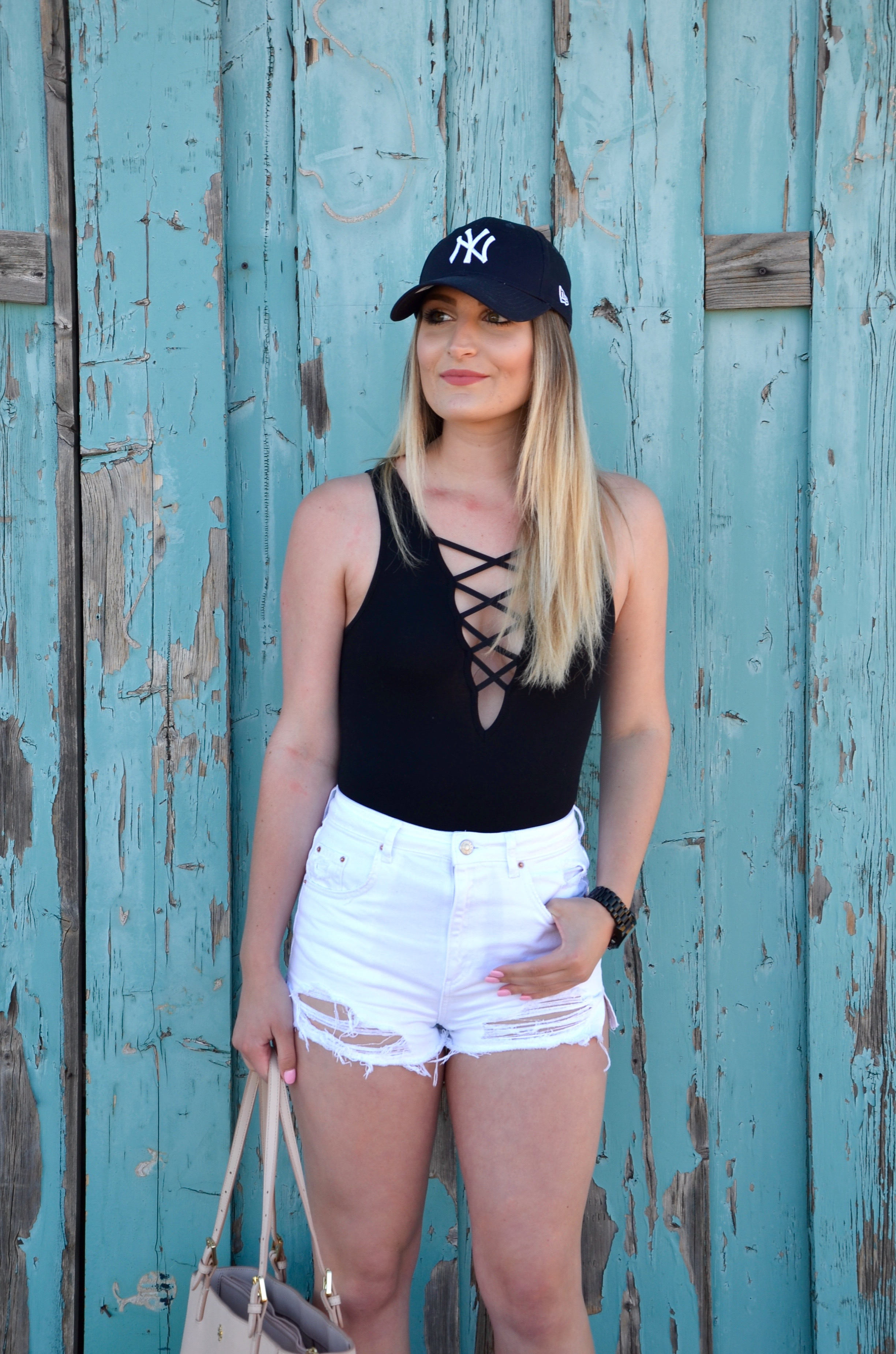 white ripped high waisted shorts - Travel Outfit Of The Day by popular Texas style blogger Audrey Madison Stowe