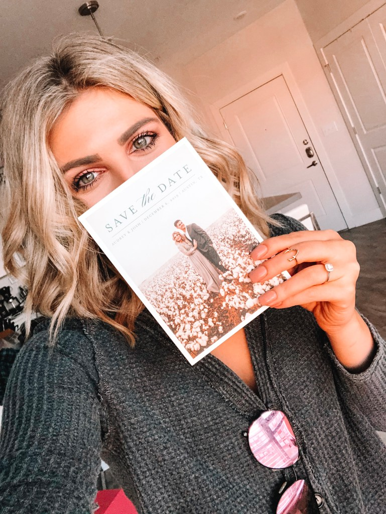 Save The Date Ideas featured by top US lifestyle blogger Audrey Madison Stowe; Image of blonde woman holding a save the date card.