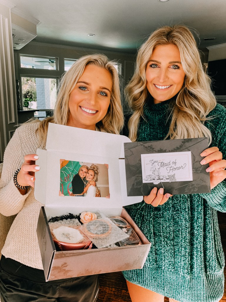How to Ask your Bridesmaids featured by top US lifestyle blogger Audrey Madison Stowe; Two women standing together smiling.