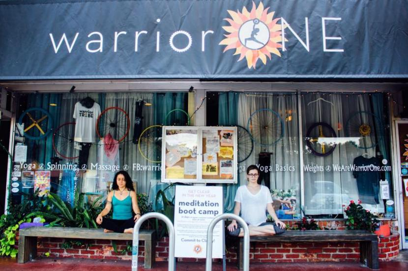 two women sitting outside of Warrior Ones yoga studio
