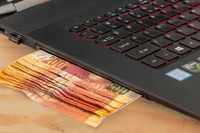 Reisen bildet – Was ist Giralgeld und wieso kostet das Abheben von Bargeld Gebühren?