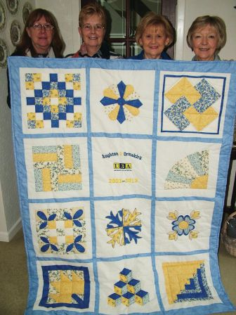 Lynn Chute, Eileen Evans, Barbara Littler and Barbara Brookfield with the 10th Anniversary Quilt