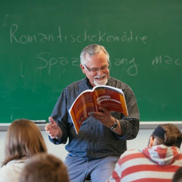 Don Clymer, here teaching a German course, has taught several languages at Eastern Mennonite University for 17 years, as well as five years as an adjunct. He also spent five years as director of cross-cultural programs at EMU. He'll be recognized with fellow retiring faculty Spencer Cowles and Ted Grimsrud at a May 3 reception at 4 p.m. in the campus center greeting hall. (Photo by Joaquin Sosa)