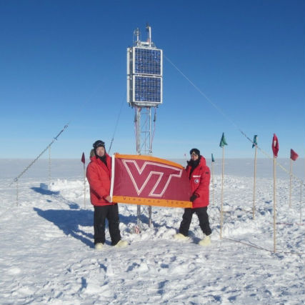 Zhonghua Xu (left) and Mike Hartinger represent Virginia Tech in front of solar panels at their base camp in Antarctica.