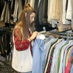 Blythe Boyd sorts through donated clothes.