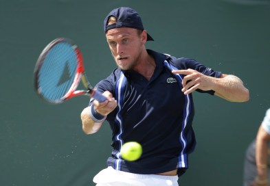 Denis Kudla returns to Milos Raonic during their match at the Miami Open tennis tournament, Saturday, March 26, 2016, in Key Biscayne, Fla. (AP Photo/Lynne Sladky)
