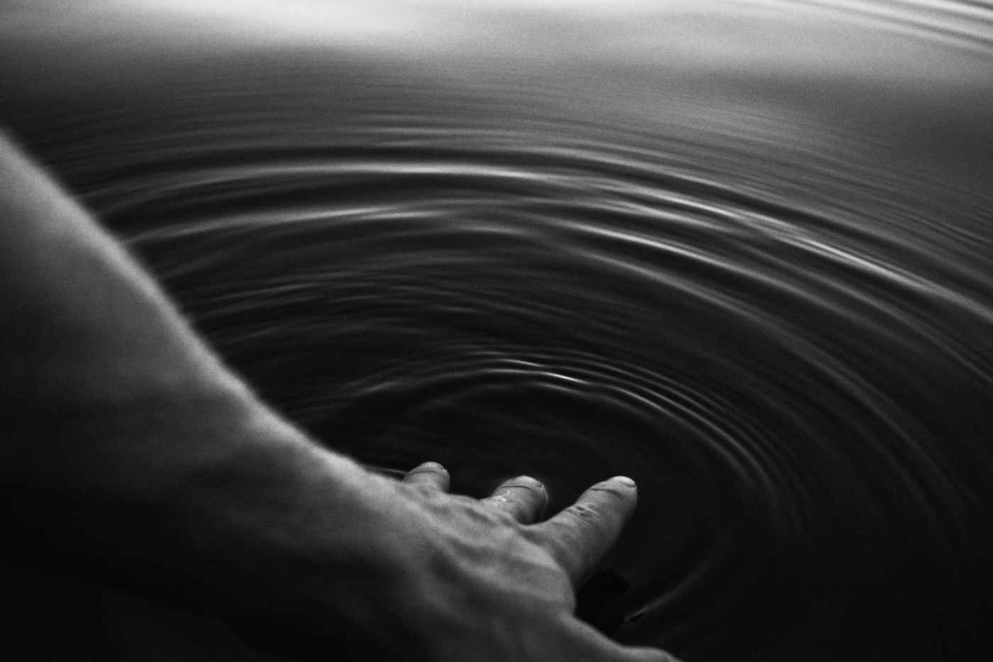 photo of person touching a body of water