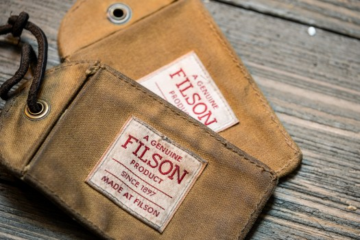 ac88a2da11 Filson luggage tag in Tin Cloth. The top one has at least a year of use  while the bottom one is essentially brand new.