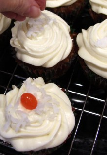 garnishing carrot cupcakes