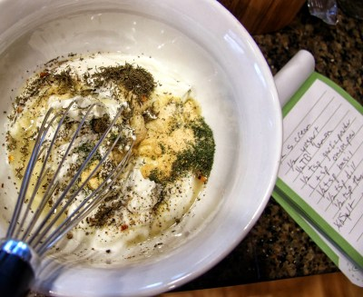 herbs stirred into sour cream and yogurt