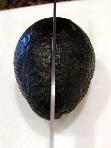 avocado being sliced in half