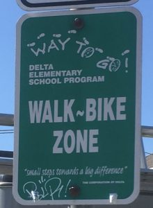 A sign encouraging students to walk and bike.