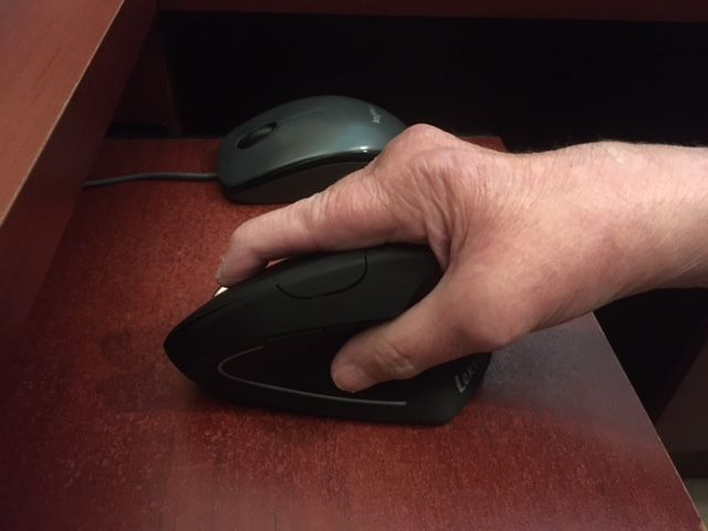 Picture of my hand resting on vertical mouse.