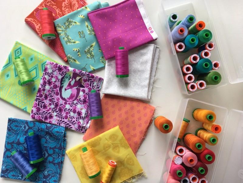 Selecting Aurifil thread to match Tula Pink fabrics