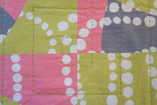 Front of Akoya, a quilt by Patricia Belyea, stitched by Victoria Stone with Aurifil 12wt thread on a Sashiko 2 machine